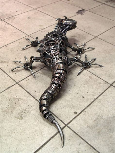 lizard made out of i recycle motorbike parts into steunk animal