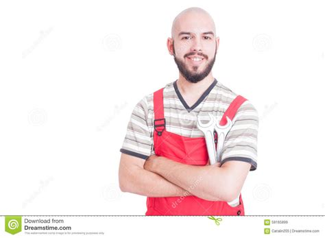 Friendly Plumber Friendly Plumber Or Mechanic Smiling And Holding Wrenches