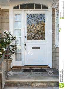 white front door white front door of upscale beige home stock photography