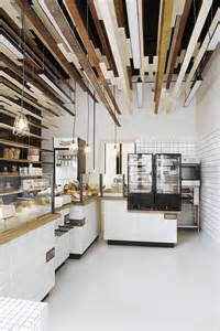 Inviting Bakery Design in Warsaw Exhibiting an Eye Catching Plywood Installation