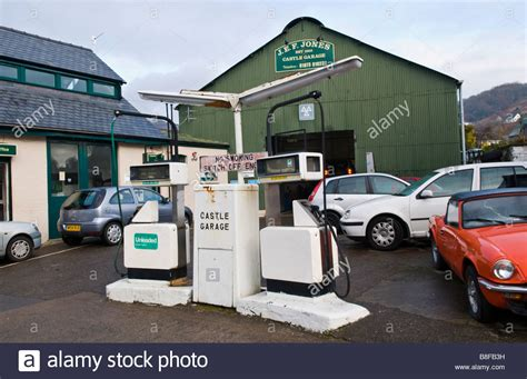 exterior of local garage with style petrol pumps and