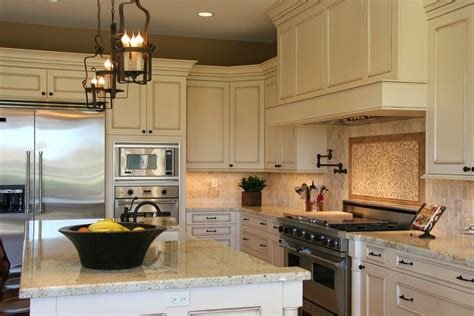 granite countertops for ivory cabinets antique cream glazed cabinets with quartz countertops