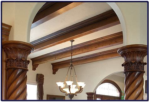 ceiling beams with wood swirl pillars