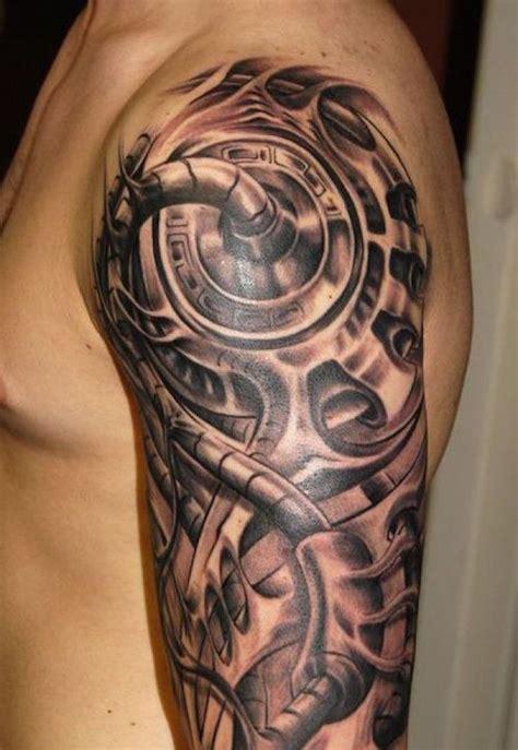 oberarm tattoo in schwarz und grau biomechanische