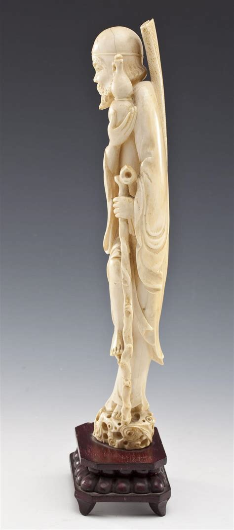 2 carved ivory figures