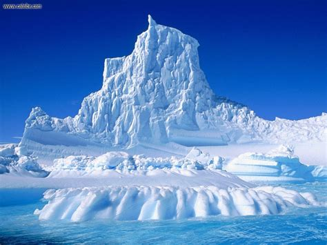 frozen waves wallpaper nature eroded iceberg in the lemaire channel antarctica