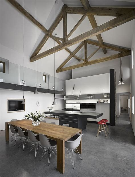 interior renovation of a century old home in canada by high ceilings with exposed wooden beams in renovated old