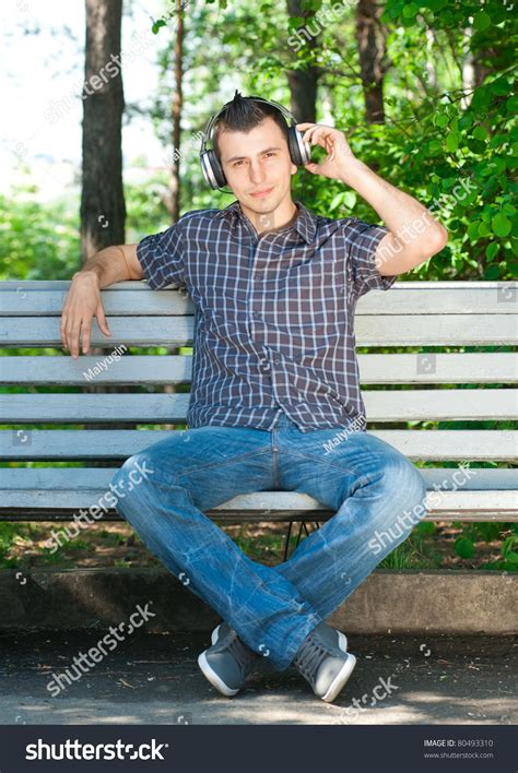 man sitting on bench portrait relaxed young man sitting on stock photo 80493310