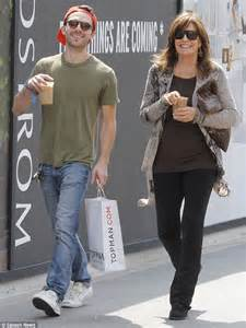 72 year old linda gray steps out with her grandson