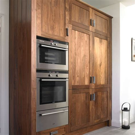 walnut cabinets kitchen double oven take a look around this chic walnut kitchen