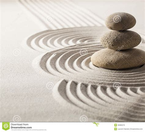 focus on balancing stones in sand for progression stock