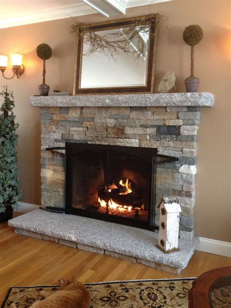 warm and cozy stone fireplace surrounds stone veneer