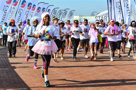 what is the purpose of the color run capitec bank partners with adopt a school to bring purpose
