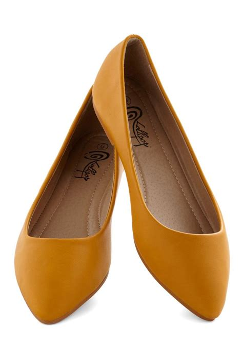 mustard color shoes defined the flat in mustard