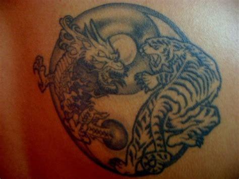 tattoo dragon tiger yin yang yin yang tattoo dragon and tiger fight tattooimages biz