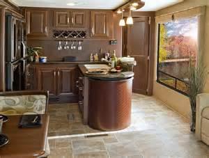 Large peninsula kitchen with a bar top and custom hardwood wine racks