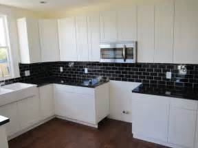 White kitchen cabinets with black granite countertops images home