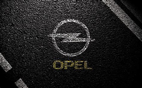 opel logo wallpaper opel symbol on asphalt wallpapers and images wallpapers