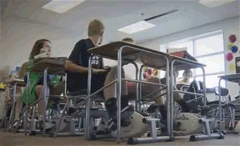 desk for indoor cycling math teacher puts cycling machines under students desks