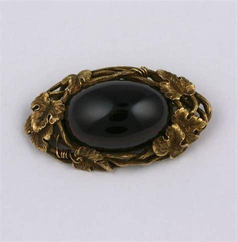 louis comfort tiffany jewelry louis comfort tiffany garnet gold grape brooch at 1stdibs
