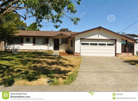 one story single story family house with driveway stock photo