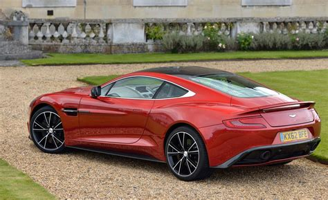 aston martin vanquish red car and driver