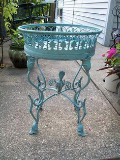 vintage white wrought iron spinning ferris wheel planter