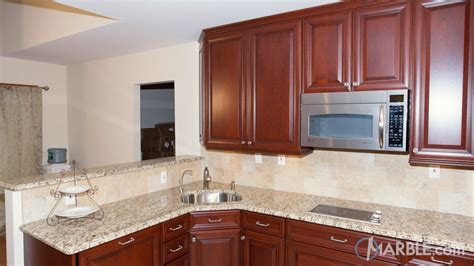cherry cabinets with granite santa cecilia granite kitchen with cherry wood cabinets