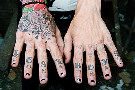 tattoo knuckles lyrics motionless in white singer learned a lesson with his