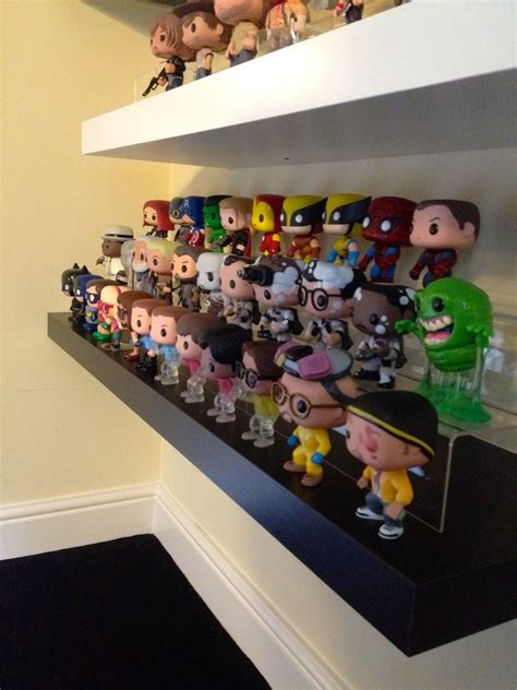 bobblehead shelves funko collection on a floating shelf from ikea i got the