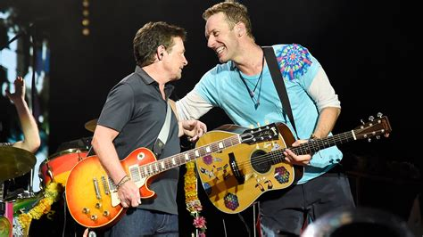 michael j fox with coldplay see michael j fox go back to the future onstage with