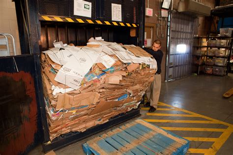 Back Room by File Removing Box Bale From Machine In Walmart Back Room