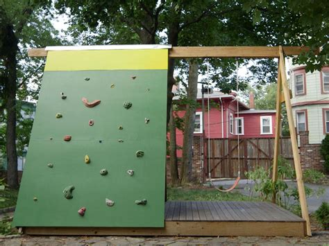 swing set with rock climbing wall build a combination swing set playhouse and climbing wall