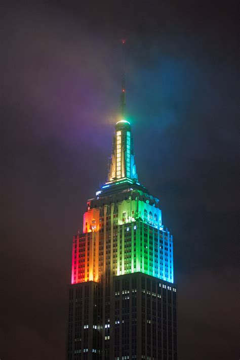rainbow color light design on empire state building at