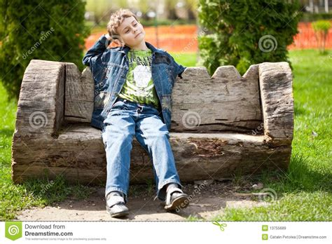kid on bench cute kid sitting on bench stock image image of happiness