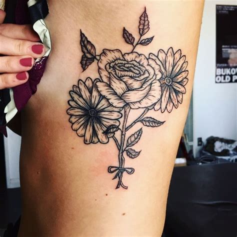 daisy tattoo on ribs two daisies and a rose tattoo on ribs tattoo ideas