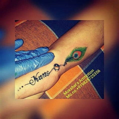 tattoo name manish kano name tattoo with peacock feather tattoo designed