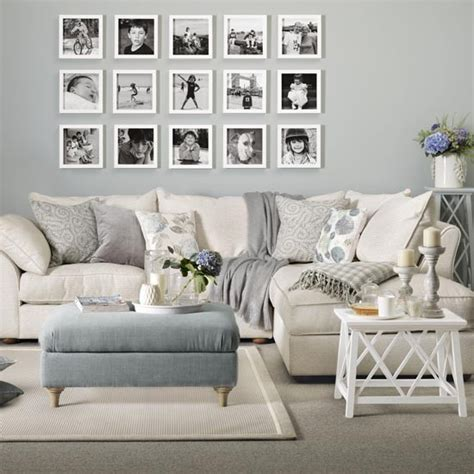 soft grey living room sofa in with grey blue footstool soft grey wall the side table looks a
