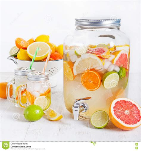 Dispenser Fruit infused water with citrus fruits royalty free stock photo