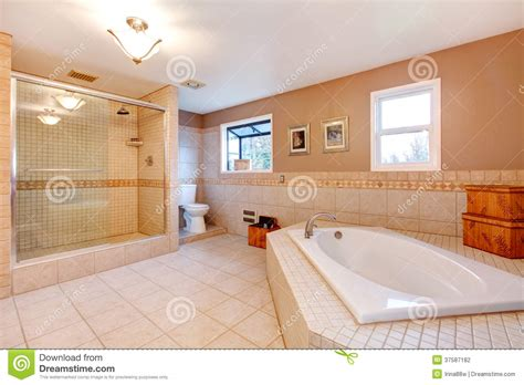 Large Tub Shower Large Warm Tones Bathroom Stock Photo Image Of Bathtub