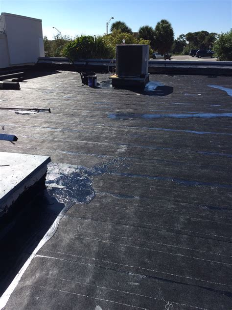 roof replacement  hot tar dolphin roofing