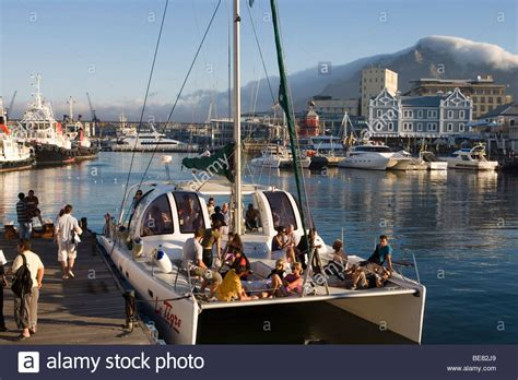 sunset cruise catamaran le tigre with waterfront and table - Catamaran Waterfront