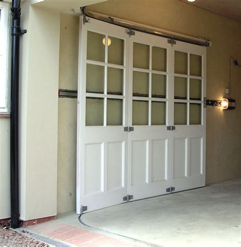 Garage Workshop Designs by Horizontally Tracked Sliding Doors Automation