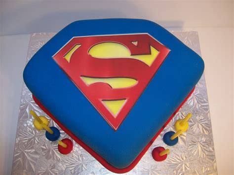 superman pink logo cake ideas and designs