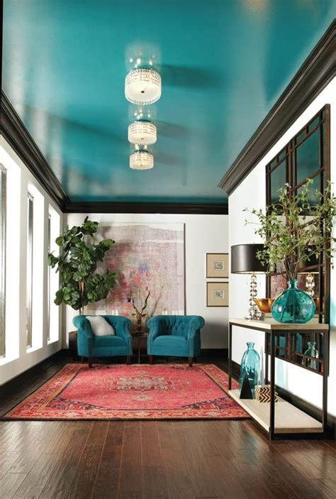 living room ceiling colors white walls are accented with striking black molding and a glossy turquoise ceiling coulter