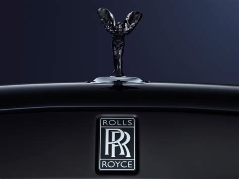 rolls royce badge rolls royce unveils their futuristic self driving concept