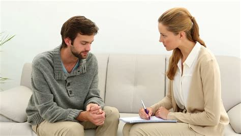 therapy session psychologist talking with depressed patient and taking
