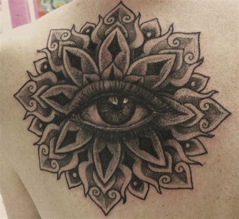 tattoo mandala eye grey ink mandala flower eye tattoo on back shoulder