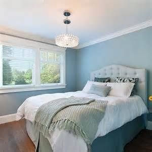 pale blue bedroom walls with white beaded mirror