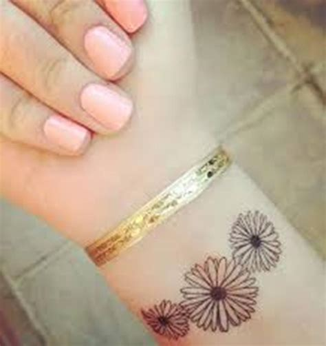 23 daisy flowers wrist tattoos